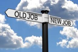 Conceptual signpost with OLD JOB, NEW JOB arrows...