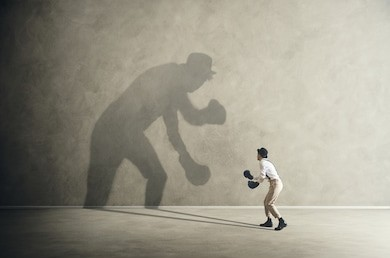 man-fighting-his-shadow-facing-260nw-629665322